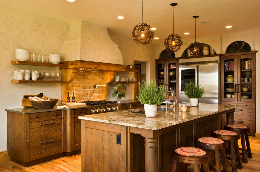 Inspiration for a rustic kitchen remodel in New York with glass-front cabinets, stainless steel appliances and subway tile backsplash