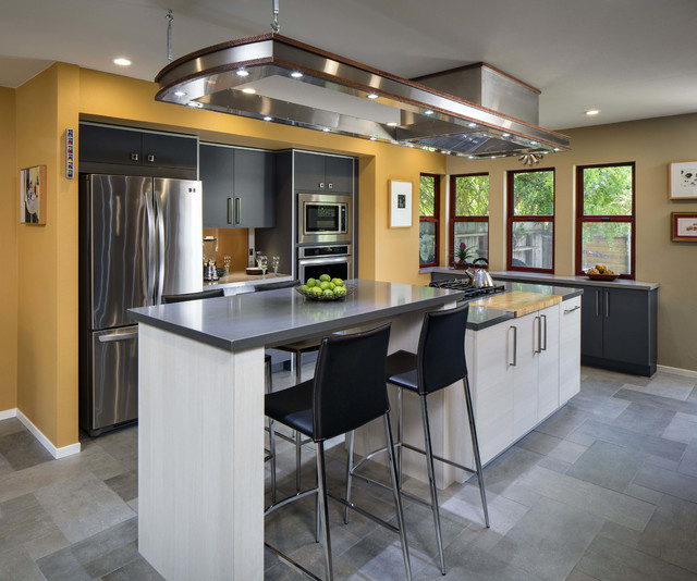 Kitchen - contemporary galley kitchen idea in Sacramento with flat-panel cabinets, black cabinets and an island
