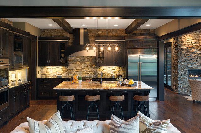 Kitchen - rustic l-shaped dark wood floor kitchen idea in Minneapolis with an undermount sink, shaker cabinets, black cabinets, multicolored backsplash and an island