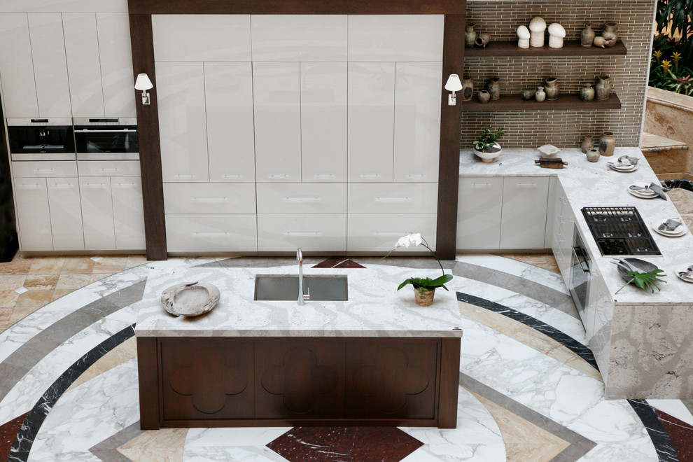 Inspiration for a modern kitchen remodel in Atlanta with quartz countertops and an island