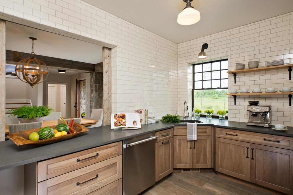 Example of a cottage dark wood floor kitchen design in New York with an undermount sink, shaker cabinets, medium tone wood cabinets, white backsplash and subway tile backsplash