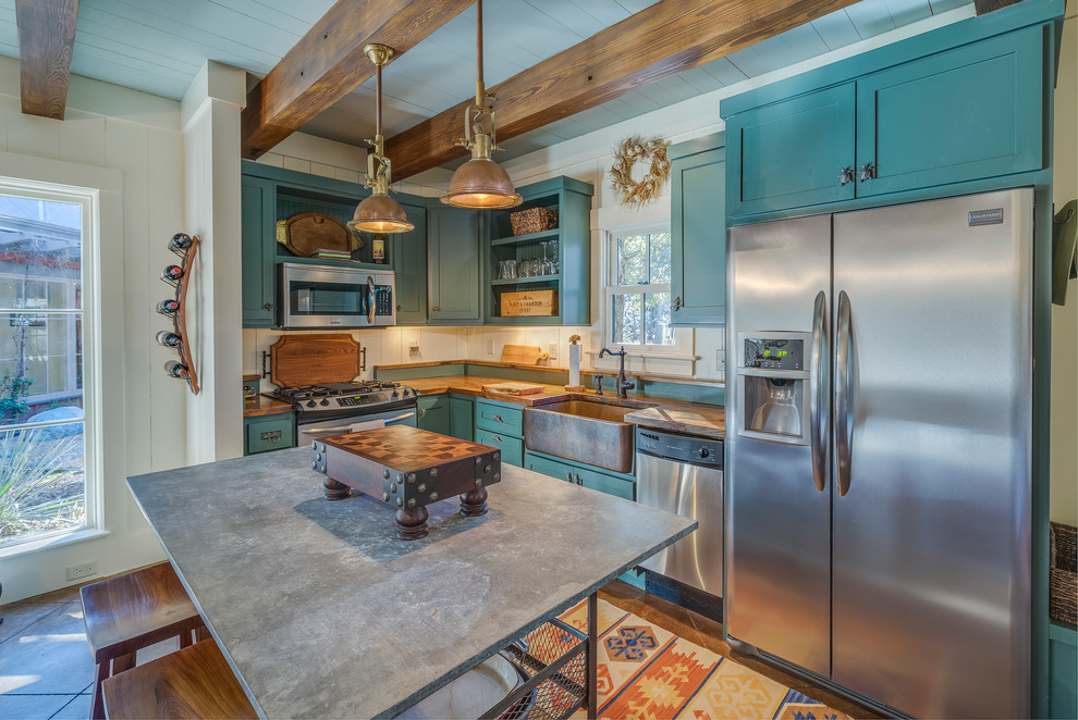 Kitchen - farmhouse l-shaped kitchen idea in Atlanta with a farmhouse sink, shaker cabinets, stainless steel appliances, an island and turquoise cabinets