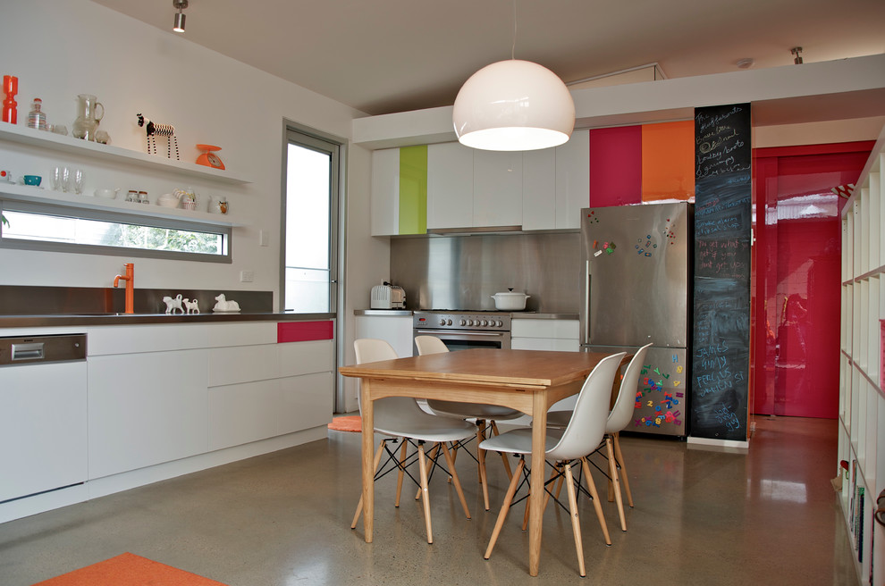 Example of an eclectic kitchen design in Adelaide with stainless steel appliances and stainless steel countertops