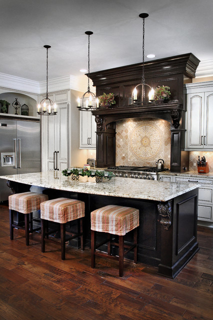 Inspiration for a timeless l-shaped dark wood floor kitchen remodel in Other with beaded inset cabinets, white cabinets, beige backsplash, ceramic backsplash, stainless steel appliances and an island