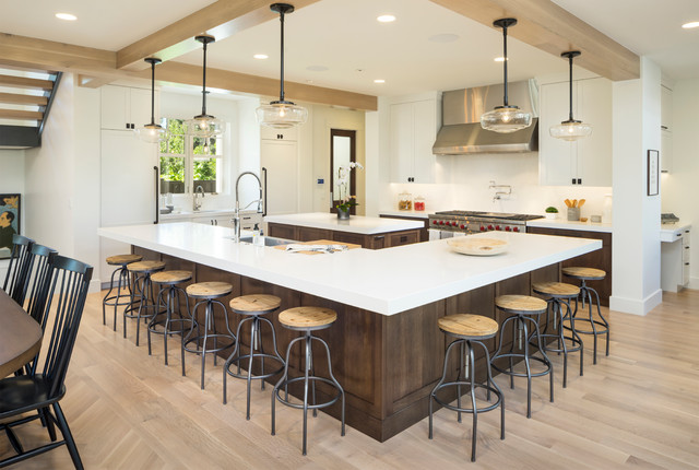 Inspiration for a huge craftsman light wood floor and beige floor kitchen remodel in Salt Lake City with a farmhouse sink, marble countertops, white backsplash, ceramic backsplash, stainless steel appliances, two islands and white countertops