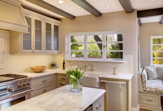 Mediterranean kitchen idea in Seattle with subway tile backsplash, a  farmhouse sink, gray cabinets
