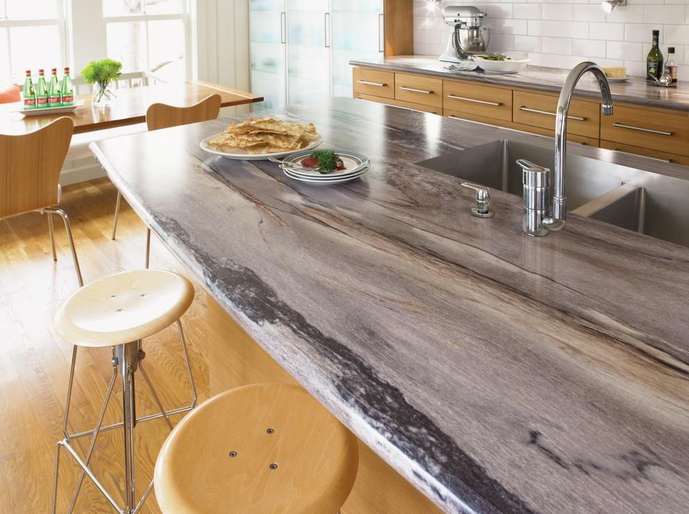 Eat-in kitchen photo in Cincinnati with white backsplash, an undermount sink and stainless steel appliances