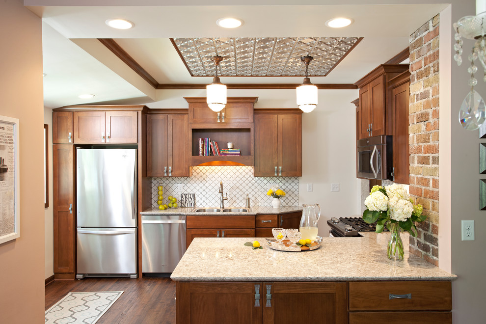 Inspiration for a small timeless u-shaped dark wood floor eat-in kitchen remodel in Minneapolis with quartz countertops, white backsplash, porcelain backsplash, stainless steel appliances, a drop-in sink, shaker cabinets, dark wood cabinets and a peninsula