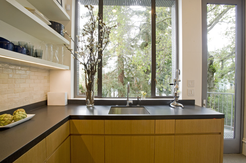 Example of a minimalist kitchen design in San Francisco with subway tile backsplash