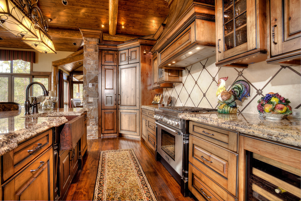 Mountain style kitchen photo in Denver with a farmhouse sink and granite countertops