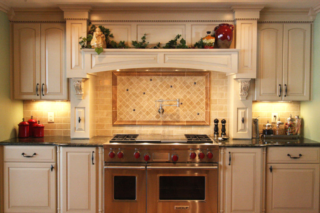 48u201d Wolf gas range with hood mantle and back-splash with pot-filler faucet - Traditional ...