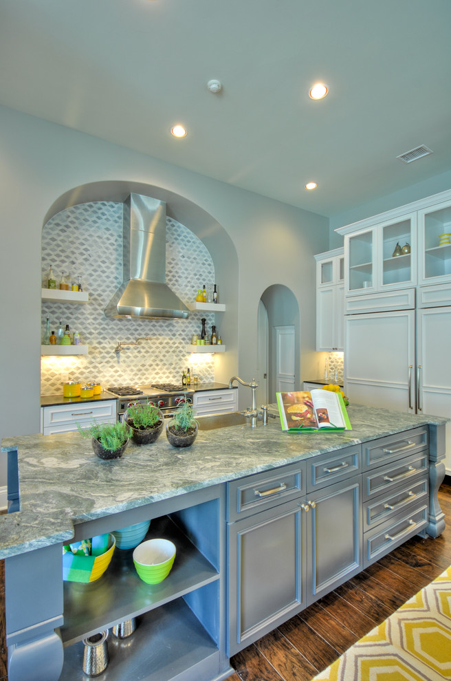 Eat-in kitchen - large contemporary u-shaped dark wood floor eat-in kitchen idea in Austin with an undermount sink, shaker cabinets, white cabinets, granite countertops, gray backsplash, porcelain backsplash, white appliances and two islands