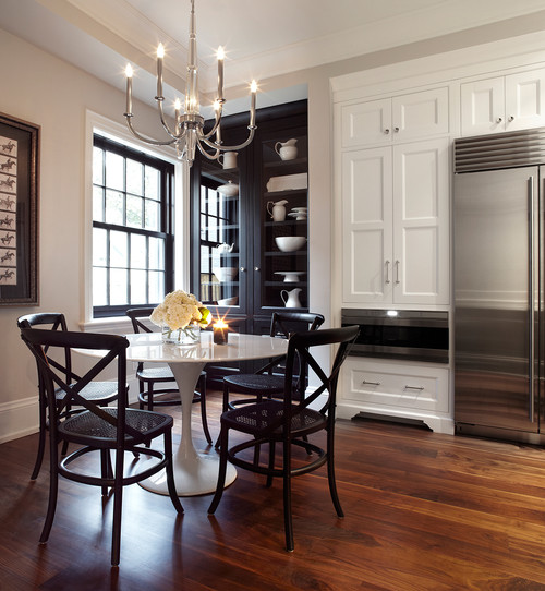 A Black and White dining room design that combines both black and white cabinets to make a dramatic effect.
