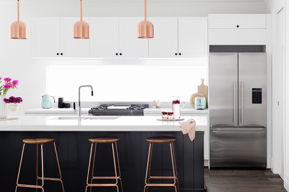This is an example of a mid-sized contemporary galley open plan kitchen in Melbourne with flat-panel cabinets, stainless steel appliances, dark hardwood floors, an undermount sink, white cabinets, window splashback, with island and brown floor.