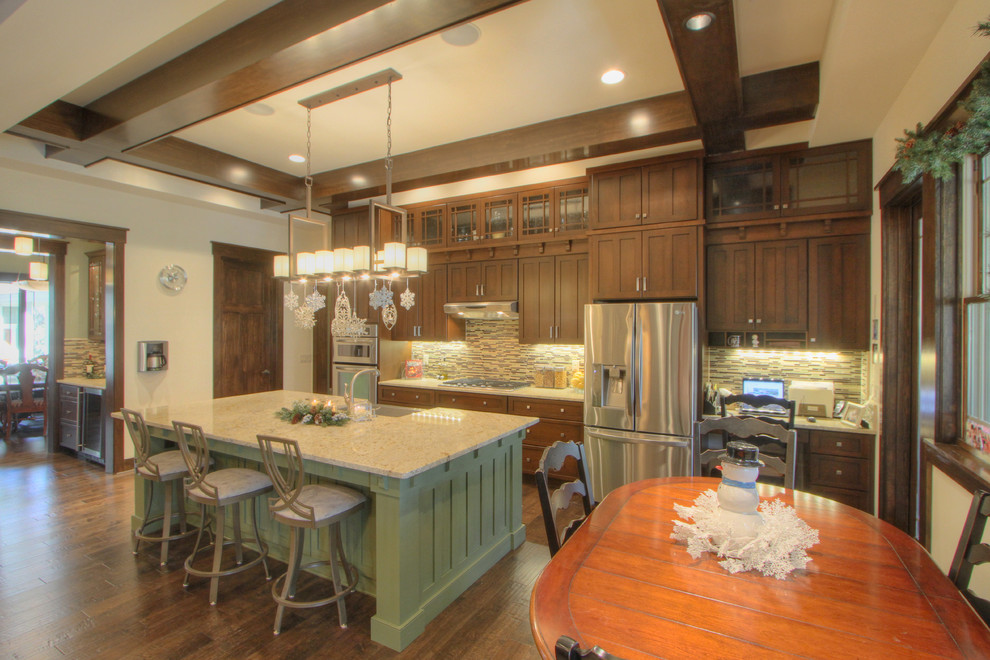 Eat-in kitchen - large craftsman dark wood floor eat-in kitchen idea in Atlanta with a single-bowl sink, glass tile backsplash, stainless steel appliances and an island