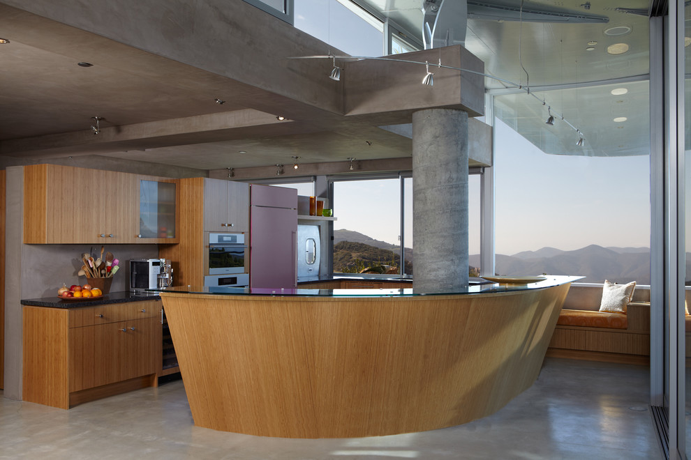Inspiration for a modern kitchen remodel in Los Angeles with flat-panel cabinets, medium tone wood cabinets and stainless steel appliances