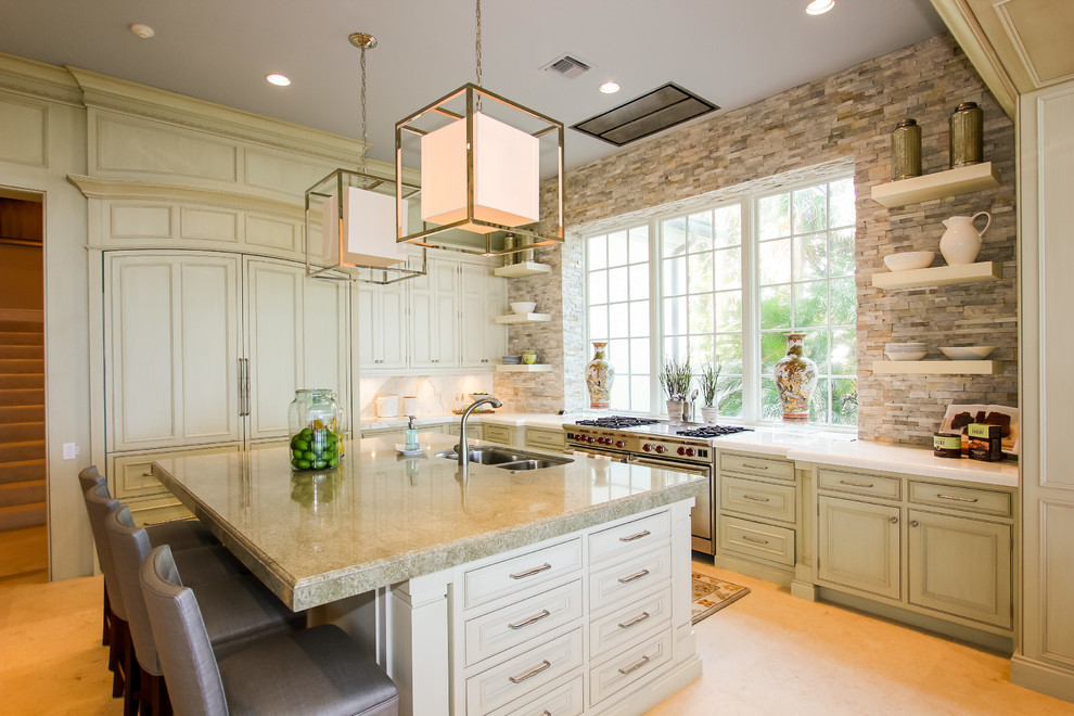 Inspiration for a mediterranean kitchen remodel in Boston with paneled appliances
