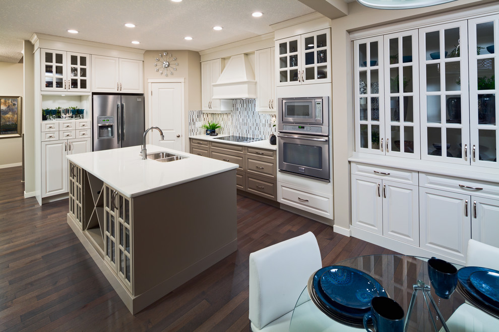 Example of a classic kitchen design in Calgary with matchstick tile backsplash, stainless steel appliances, gray backsplash and a double-bowl sink
