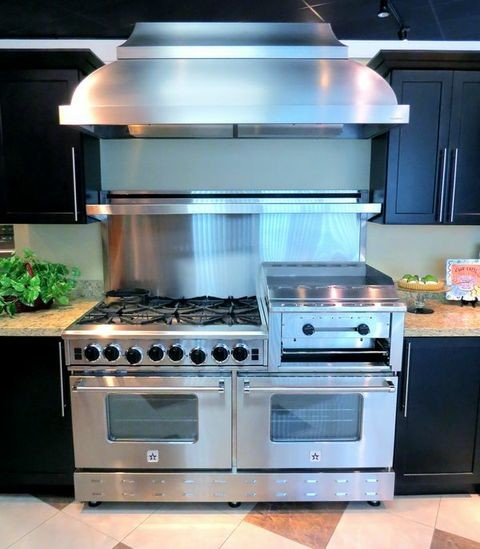 Inspiration for a contemporary l-shaped enclosed kitchen remodel in Philadelphia with stainless steel appliances