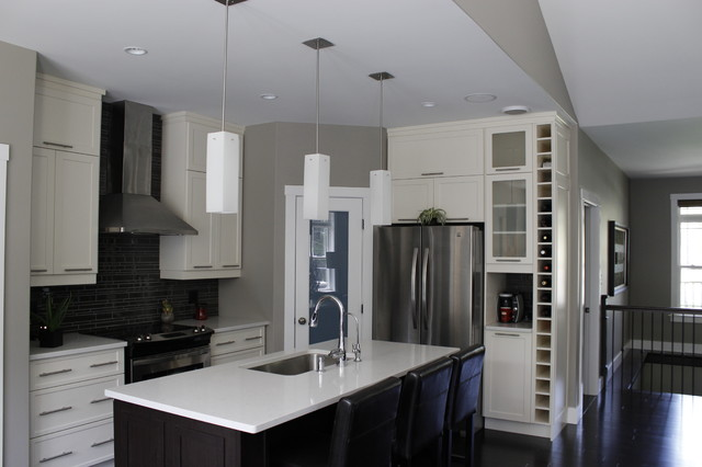 A compact kitchen and corner pantry are very functional for this busy family