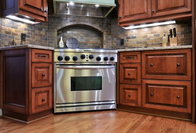 A corner range takes center stage traditional kitchen atlanta by cynthia karegeannes Kitchen design center stove