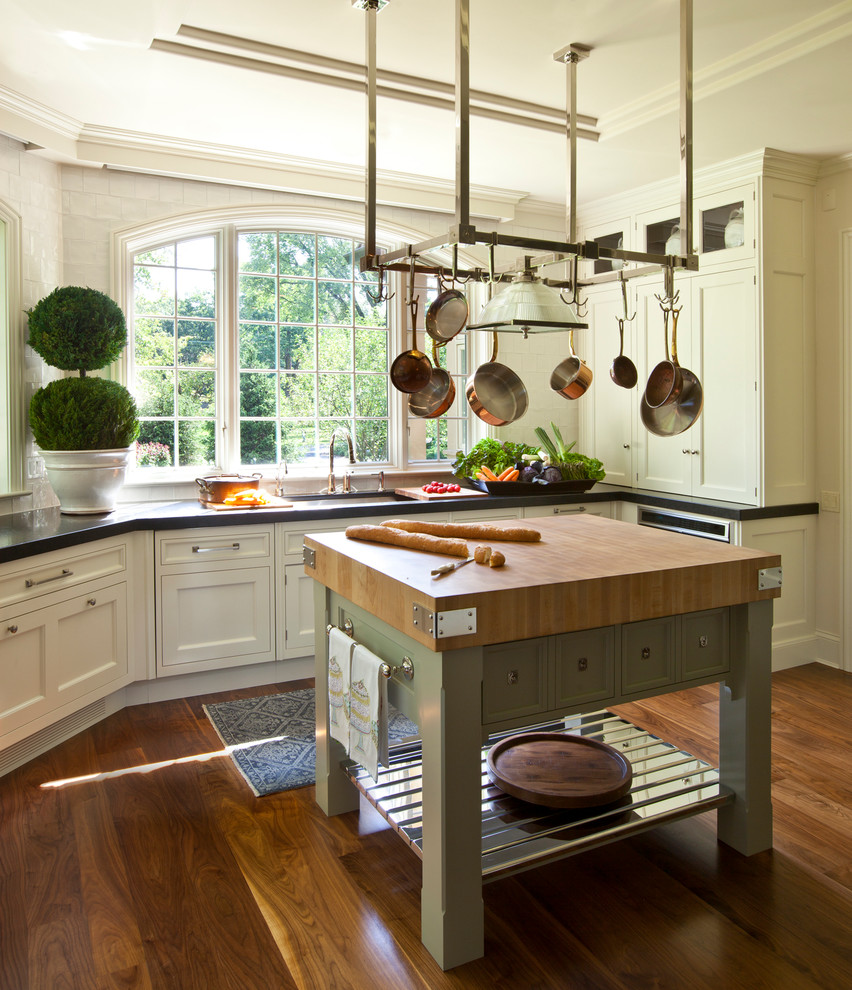 Kitchen - traditional medium tone wood floor kitchen idea in Chicago with an undermount sink, shaker cabinets, white cabinets, wood countertops, stainless steel appliances and an island