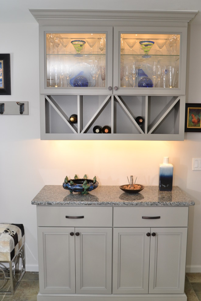 Example of a small trendy l-shaped terra-cotta tile eat-in kitchen design in Philadelphia with an undermount sink, flat-panel cabinets, gray cabinets, granite countertops, gray backsplash, mosaic tile backsplash, stainless steel appliances and an island