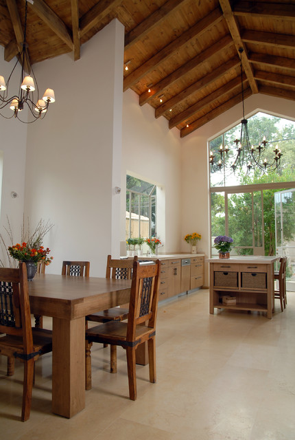 Tuscan eat-in kitchen photo in Other with flat-panel cabinets and medium tone wood cabinets