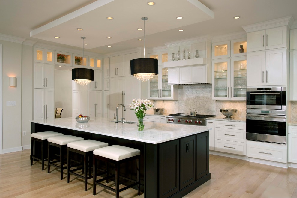 Example of a large trendy galley light wood floor open concept kitchen design in DC Metro with an undermount sink, shaker cabinets, white cabinets, marble countertops, multicolored backsplash, stone slab backsplash, stainless steel appliances and an island