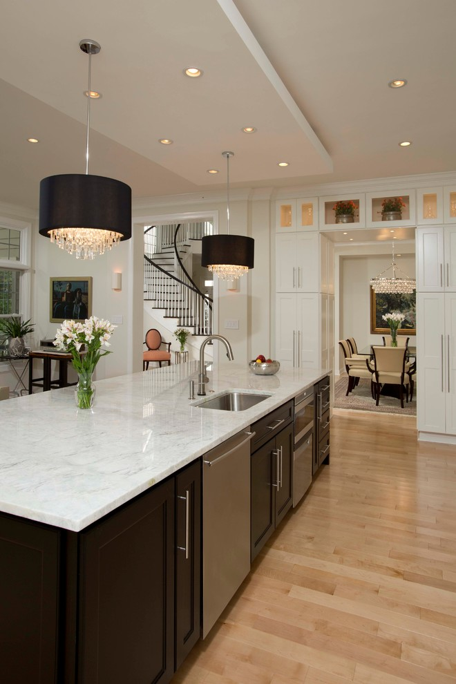Example of a large trendy light wood floor open concept kitchen design in DC Metro with an undermount sink, shaker cabinets, white cabinets, marble countertops, multicolored backsplash, stone slab backsplash, stainless steel appliances and an island