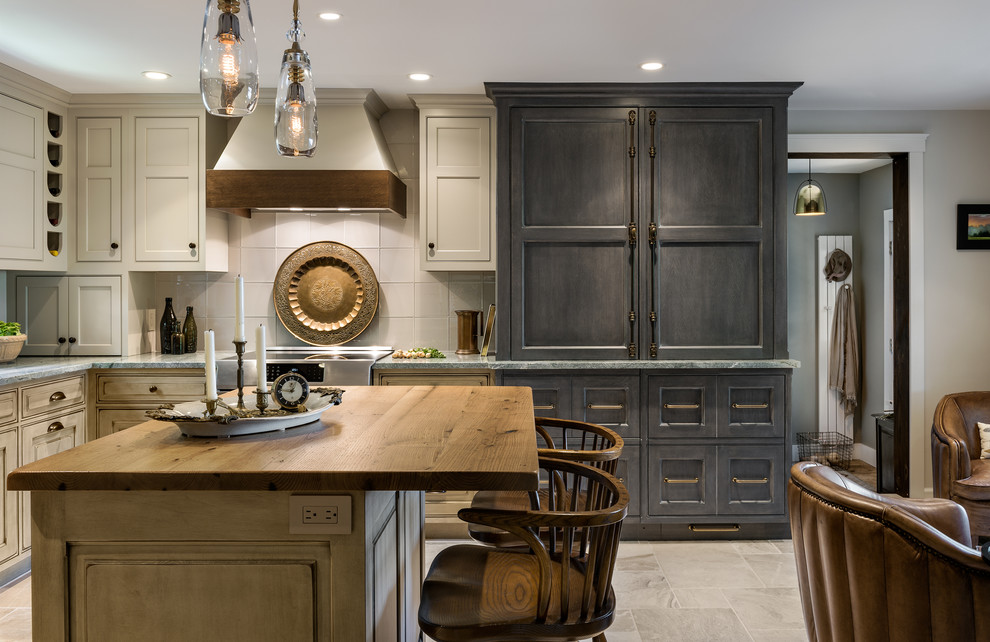Transitional l-shaped kitchen photo in Boston with shaker cabinets, gray cabinets, stainless steel appliances and an island