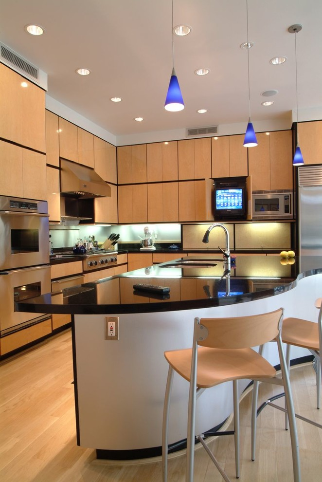 Inspiration for a contemporary light wood floor kitchen remodel in Jackson with an undermount sink, flat-panel cabinets and stainless steel appliances