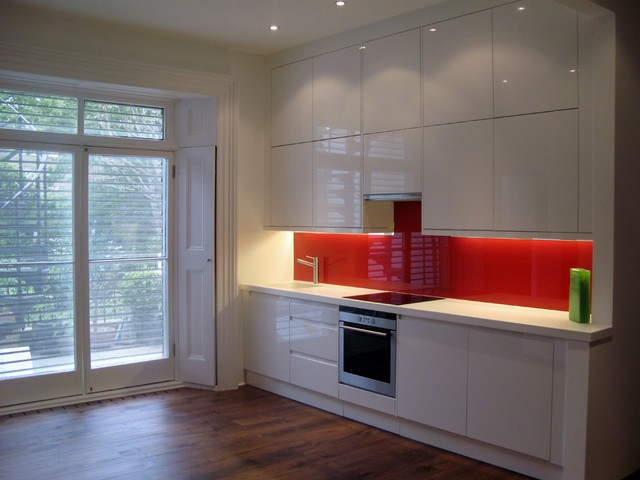 a magnet kitchen fitted with painted glass splashbacks