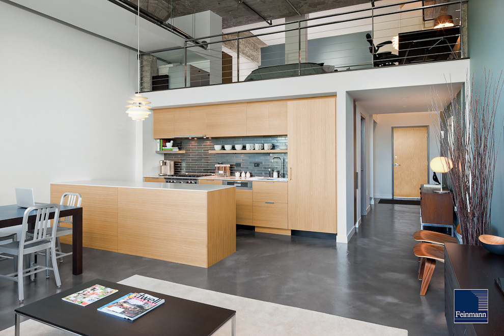 Open concept kitchen - contemporary single-wall gray floor open concept kitchen idea in Boston with flat-panel cabinets, light wood cabinets, gray backsplash and paneled appliances