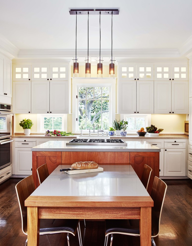 Example of a transitional dark wood floor eat-in kitchen design in San Francisco with raised-panel cabinets, white cabinets, yellow backsplash, stainless steel appliances and an island