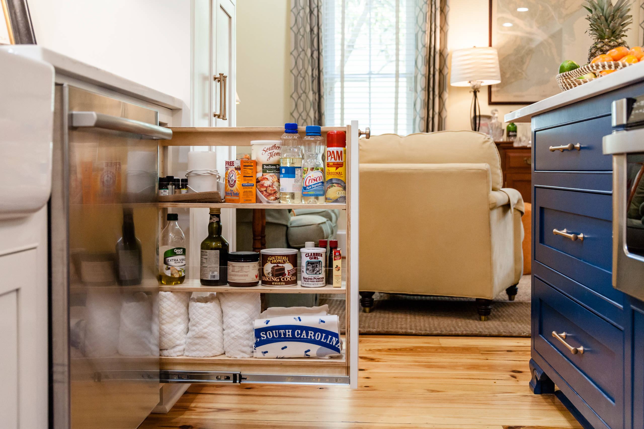 A pull-out rack holds baking gear and kitchen essentials