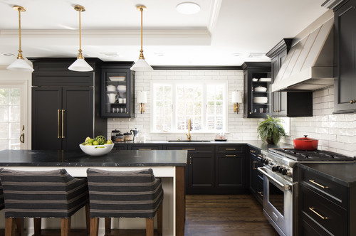 Countertops pairings for a black and gold kitchen and bath