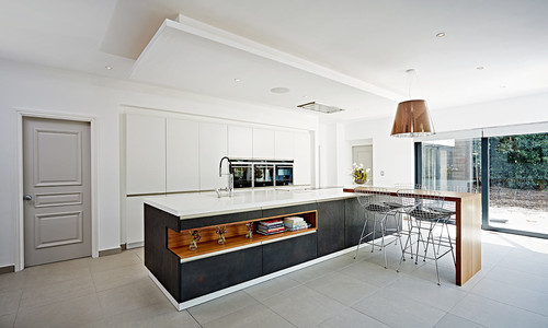 A STYLISH STONE SLATE AND TORONTO WHITE LACQUER KITCHEN