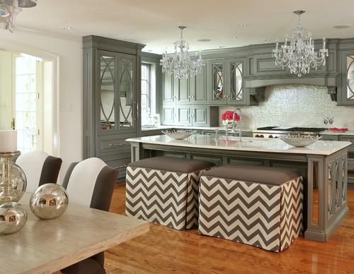 Gray and white kitchen design with mirrored cabinets.