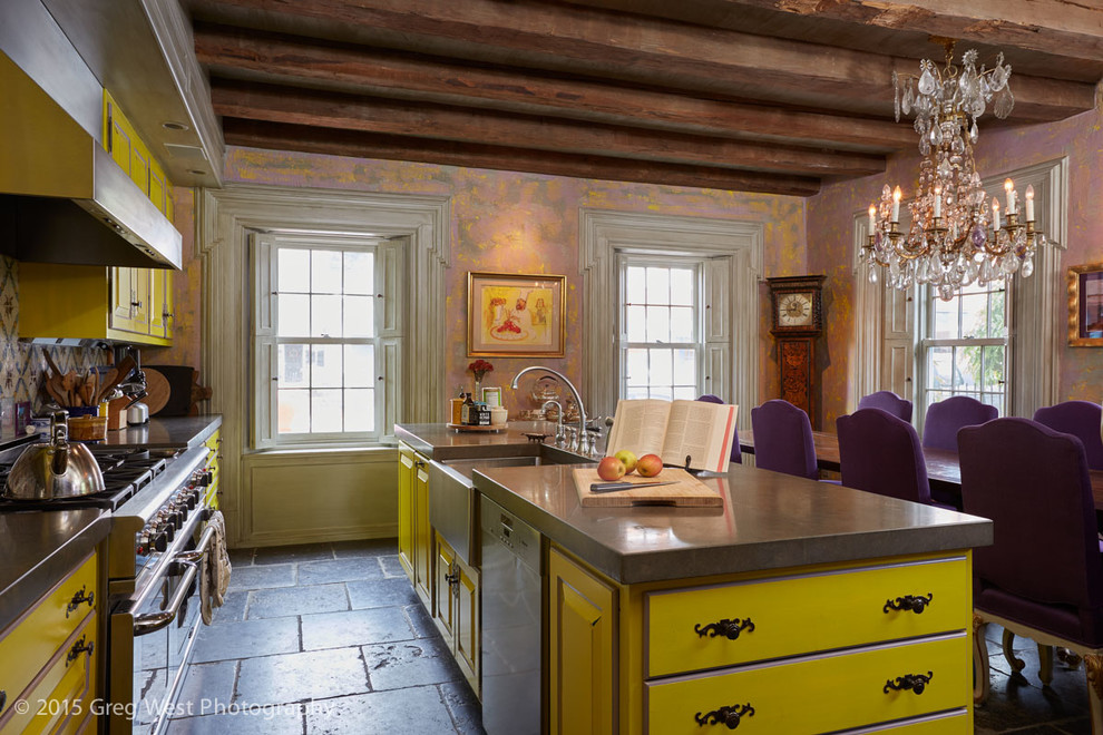 Eat-in kitchen - large eclectic single-wall gray floor eat-in kitchen idea in Boston with a farmhouse sink, raised-panel cabinets, yellow cabinets, concrete countertops, multicolored backsplash, mosaic tile backsplash, stainless steel appliances, an island and gray countertops