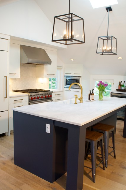 Minimalist galley light wood floor kitchen photo in Denver with a farmhouse sink, flat-panel cabinets, paneled appliances and an island