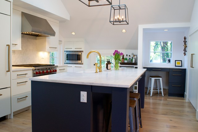 Inspiration for a modern galley light wood floor kitchen remodel in Denver with a farmhouse sink, flat-panel cabinets, paneled appliances and an island