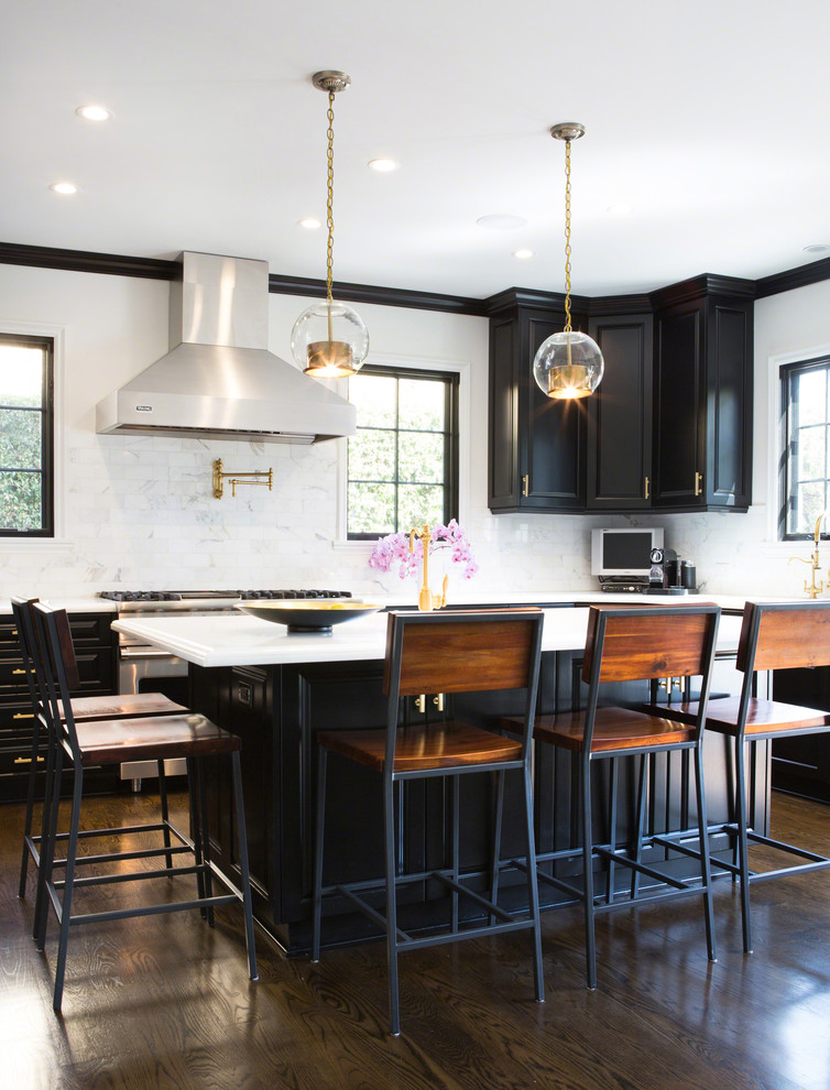 Example of a transitional dark wood floor kitchen design in Los Angeles with recessed-panel cabinets, black cabinets, white backsplash and stainless steel appliances
