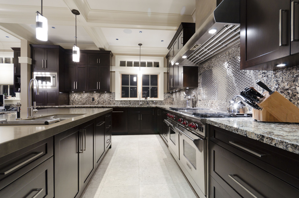 Inspiration for a contemporary kitchen remodel in Vancouver with an undermount sink, shaker cabinets, dark wood cabinets and stainless steel appliances