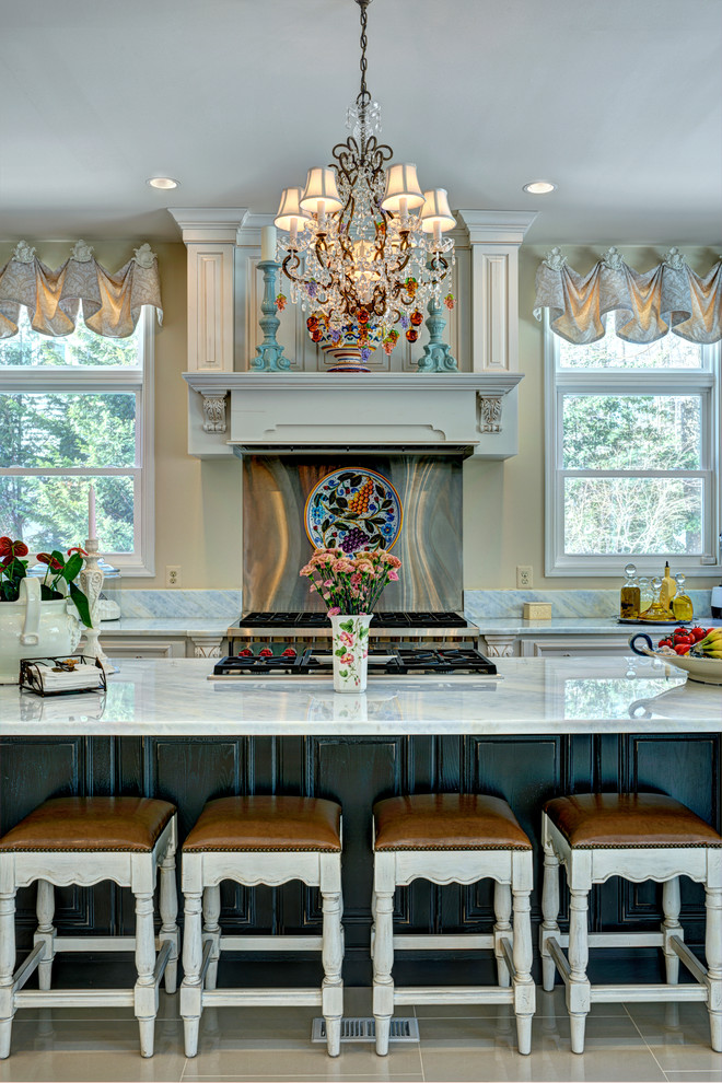 Inspiration for a large mediterranean l-shaped porcelain tile open concept kitchen remodel in DC Metro with a double-bowl sink, metallic backsplash, stainless steel appliances and an island