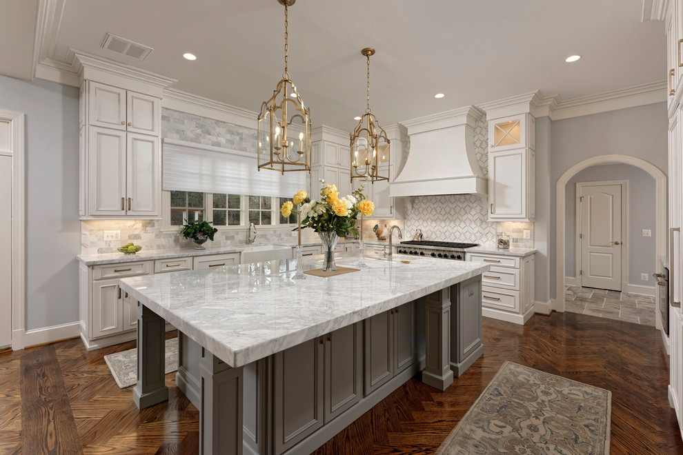 Large elegant l-shaped dark wood floor and brown floor eat-in kitchen photo in DC Metro with a farmhouse sink, recessed-panel cabinets, white cabinets, multicolored backsplash, stainless steel appliances, an island, multicolored countertops, marble countertops and mosaic tile backsplash