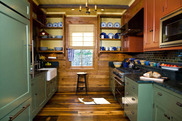 Kitchen - rustic galley medium tone wood floor kitchen idea in Burlington with a farmhouse sink, shaker cabinets, black backsplash, subway tile backsplash, black appliances and no island