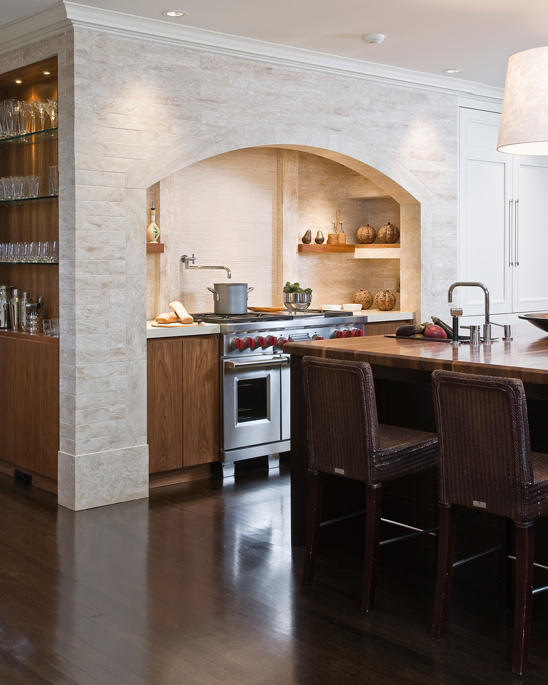 Transitional kitchen photo in Boston with wood countertops, flat-panel cabinets and medium tone wood cabinets