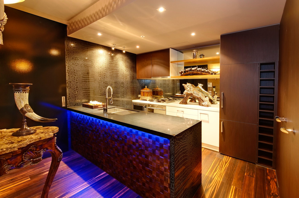 Example of an eclectic kitchen design in Melbourne with flat-panel cabinets