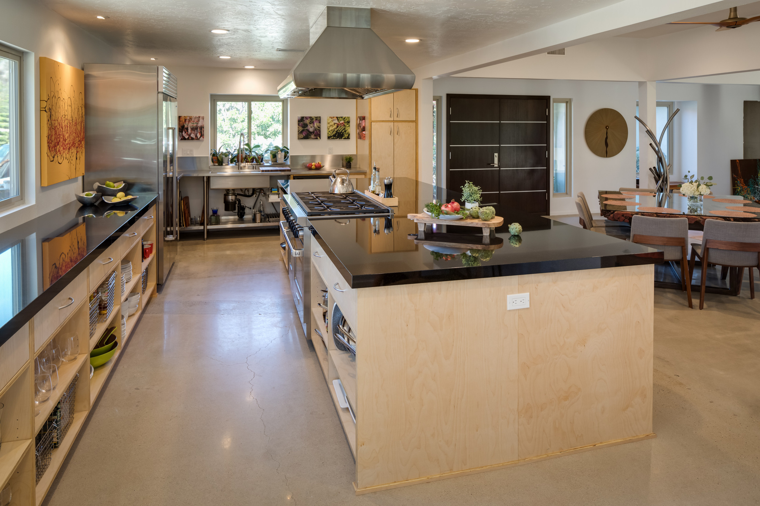 After: Open concept w/ dropped beam, large island.